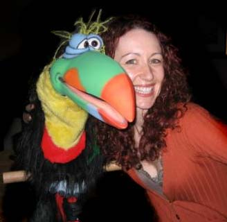 Melanie with her Animatronic Hands-Free Toucan