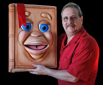 Steve Wronker with the Big Book Puppet by Axtell Expressions