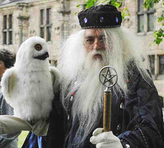 Kramus the Wizard with the realistic Snowy Owl